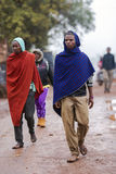 African men walking on the street in colorful capes of Maasai Mara Stock Photo