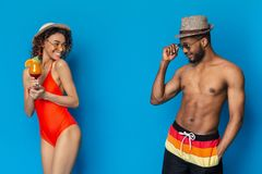 African millennials flirting, girl and guy falling in love at beach party. Summer romance. African millennials flirting, girl and guy falling in love at beach stock images