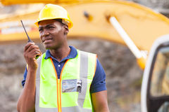 African mine worker. African american mine worker with walkie-talkie at mining site royalty free stock photography