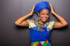 African model traditional attire. Beautiful african model in traditional attire posing on black background Stock Photo