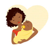 African mother and baby. African mother holding baby in front of a heart Stock Photos