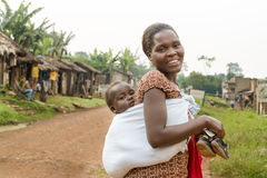 African mother with baby in sling Royalty Free Stock Image