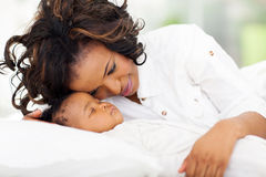 African mother looking baby Stock Image