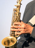African musician hand playing music with trumpet Royalty Free Stock Photography