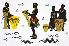 African Musicians. Dance and play the drums Royalty Free Stock Photos