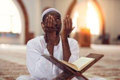 African Muslim Man Making Traditional Prayer To God While Wearing Dishdasha stock image