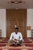 African Muslim Man Reading Holy Islamic Book Koran Stock Photos
