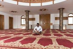 African Muslim Man Reading Holy Islamic Book Koran Royalty Free Stock Images