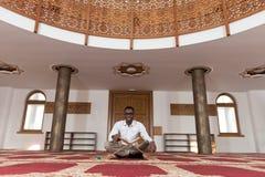 African Muslim Man Reading Holy Islamic Book Koran Stock Images