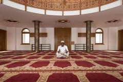 African Muslim Man Reading Holy Islamic Book Koran Royalty Free Stock Photography