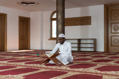 African Muslim Man Reading Holy Islamic Book Koran Royalty Free Stock Photo
