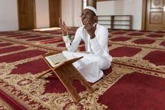 African Muslim Man Reading Holy Islamic Book Koran Royalty Free Stock Photos