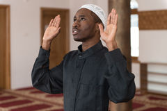 African Muslim Praying In Mosque Stock Images