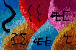 African native art on a small carpet. Close up of a small-colored carpet with african native designes Stock Photo