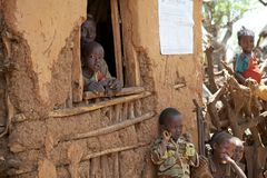 African old man and child. At the window at the village of the Konso ethnic group, Ethiopia Royalty Free Stock Image