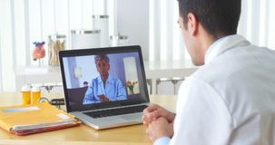 African patient video chatting with elderly patient Stock Images