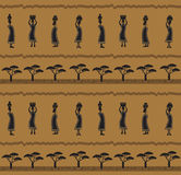 African Pattern. Stylized pattern of a silhouetted African women carrying baskets. Eps10 Royalty Free Stock Photography