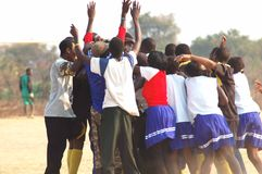African people celebrating. African farm people celebrating a win at the soccer match Royalty Free Stock Image