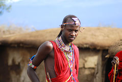 African people from Masai tribe. AMBOSELI, KENYA - OCT 13: Unidentified African people from Masai tribe prepare to show a traditional Jump dance on Oct 13, 2011 Royalty Free Stock Images