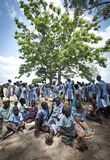 African people shading under a tree in the heat of the sun Royalty Free Stock Images