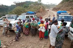 African people and tourism. African people of the Dorze ethnic group are meeting some tourists along the road from Arba Minch to the Dorze village, Ethiopia Stock Image