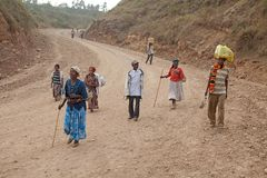 African people are walking. African people of the Dorze ethnic group are walking along the road from Arba Minch to the Dorze village in the Guge mountains Royalty Free Stock Image
