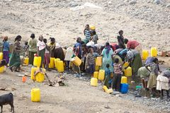 African people and water. African people are taking water at the river along the road to Arba Minch, Ethiopia Royalty Free Stock Photo