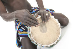 African person with djembe on white background Royalty Free Stock Photography