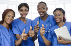 African physician team thumbs up Stock Photo