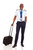 African pilot briefcase. Smiling african pilot with briefcase isolated on white stock images
