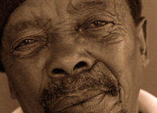 African. Portrait of black, older, south african man, showing satisfaction for life and an inner peace Stock Images