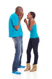 African pregnancy test. Excited african girl showing her boyfriend home pregnancy test royalty free stock photo