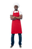 African professional chef with uniform. Confident male chef standing with arms crossed Stock Photography