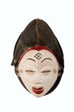 African Mask. An African Punu female ceremonial mask from Cameroon, carved in wood with white pigment signifying anti-witchcraft powers, isolated on white royalty free stock photography
