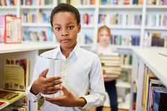African pupil in the library. Of the school or a bookstore royalty free stock image