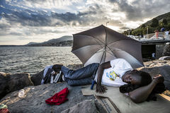 African refugees blocked in Italy. African Refugee blocked in the border from Italy and France - Ventimiglia stock photo