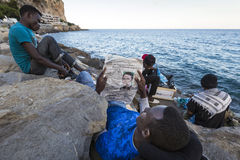 African refugees blocked in Italy. African Refugee blocked in the border from Italy and France - Ventimiglia royalty free stock images