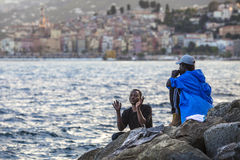 African refugees blocked in Italy. African Refugee blocked in the border from Italy and France - Ventimiglia stock photos
