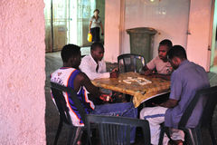 African refugees in Israel. ASHDOD, ISR - AUG 28:Sudanese refugees men play's Dominoes on August 29 2010. There are currently an estimated 60,000 African stock photo