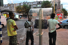 African refugees in Israel. ASHDOD, ISR - AUG 28:Sudanese refugees men talk on a public phone on August 29 2010. There are currently an estimated 60,000 African royalty free stock photos