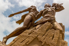 African Renaissance Monument. A 49 meter tall bronze statue of a man, woman and child, in Dakar, Senegal stock photo