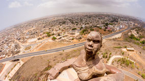 African Renaissance Monument. A 49 meter tall bronze statue of a man, woman and child, in Dakar, Senegal stock image