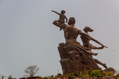 African Renaissance Monument. A 49 meter tall bronze statue of a man, woman and child, in Dakar, Senegal royalty free stock photos