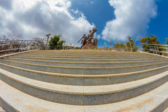 African Renaissance Monument. A 49 meter tall bronze statue of a man, woman and child, in Dakar, Senegal royalty free stock image