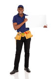 African repairman white board. Professional african repairman holding white board Royalty Free Stock Photography