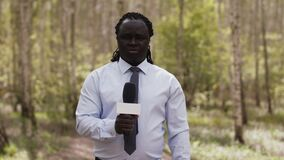 African reporter with face medical mask and gloves in the forest