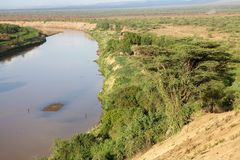 African river. Omo river landscape near the village of the Karo ethnic group, Ethiopia. The Omo River is an important river of southern Ethiopia. Its course is stock photo