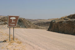 African road sign. Road sign showing distance to next resting place on dusty Namibian highway royalty free stock photo