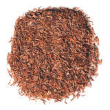 African Rooibos tea. African herbal Rooibos tea leaves isolated over white Royalty Free Stock Photos