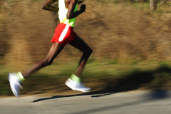 African Runner legs. On the road with panning blur Royalty Free Stock Images